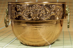 Cauldron of copper with engraved motifs Stock Image