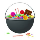 A cauldron with different candy and sweets. Halloween Royalty Free Stock Photo