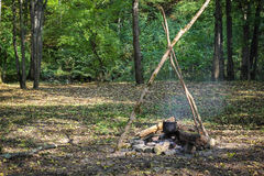 Cauldron on fire in forest Royalty Free Stock Photos