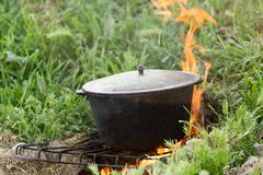 Cauldron on the fire on the nature Stock Photography