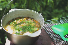Cauldron with fish soup. On the table Stock Photos