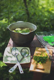 Cauldron with fish soup. On the table Stock Images