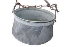 Cauldron isolated. Photography of old cauldron on chain isolated on white.PNG format avaible with transparent background stock photo