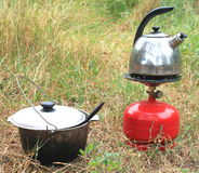 Cauldron, kettle and gas primus in summer on the grass Stock Photos