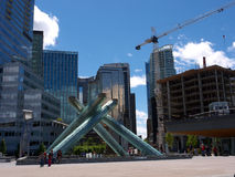 The Cauldron monument in Vancouver downtown. The Cauldron monument from the winter olympics in Vancouver located in downtown with modern skyscrapers in the Stock Photos