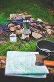 Cauldron and a mug near a campfire. Stock Images
