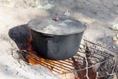 Cauldron on the nature Stock Image