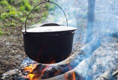 Cauldron on the open fire. Cooking in the cauldron on the open fire Stock Photography