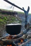 Cauldron on the open fire Royalty Free Stock Photo