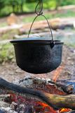 Cauldron on the open fire. Cooking in the cauldron on the open fire Royalty Free Stock Images