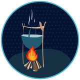 Cauldron over a fire in a circle with polka dots. Stylized tourist theme for travel and adventure Royalty Free Stock Photo