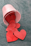 Cauldron pouring red hearts Stock Photos