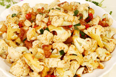 Cauliflower. And tomato bake srved on a plate Stock Photos