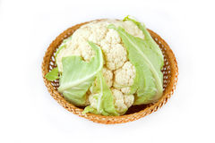 Cauliflower. In the basket on the white background Royalty Free Stock Photo