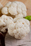 Cauliflower. Placed on wooden background Royalty Free Stock Image