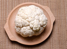 Cauliflower. Fresh and natural cauliflower in a wood bowl Royalty Free Stock Photography