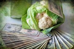 Cauliflower And Dollars Stock Photo