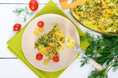 Cauliflower baked with cheese, greens and egg. A large piece on a plate. Stock Image