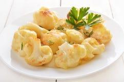 Cauliflower baked with egg Stock Photos