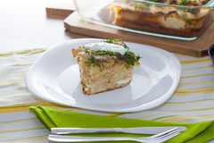 Cauliflower baked with eggs, cheese and parsley Royalty Free Stock Photography