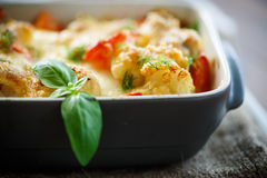 Cauliflower baked with  tomatoes Stock Images