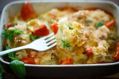 Cauliflower baked with  tomatoes Royalty Free Stock Images