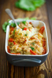 Cauliflower baked with  tomatoes Royalty Free Stock Image