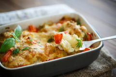 Cauliflower baked with  tomatoes Royalty Free Stock Photo