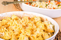 Cauliflower baked in a white casserole sprinkled with cheese Royalty Free Stock Photography