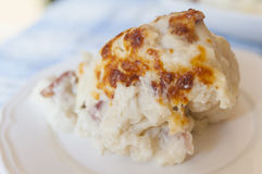 Cauliflower with bechamel. And ham hocks royalty free stock images