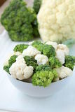 Cauliflower and broccoli. In a white cup on a blue background Stock Photography