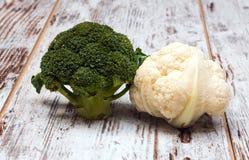 Cauliflower and broccoli. Cauliflower broccoli alongside a rustic background Royalty Free Stock Photography