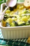 Cauliflower and broccoli baked in cream sauce. Stock Photo