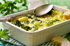 Cauliflower and broccoli baked in cream sauce. Royalty Free Stock Images