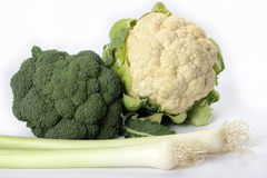 Cauliflower, broccoli and leek. Fresh leeks, cauliflower and broccoli on a white background Royalty Free Stock Image