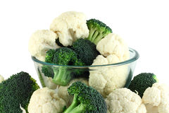 Cauliflower and broccoli in transparent bowl. Isolated on white Royalty Free Stock Photos