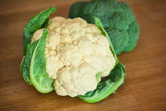Cauliflower and broccoli on the wooden board Stock Images