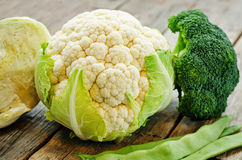 Cauliflower, cabbage, broccoli and green beans. On a dark wood background. the toning. selective focus Stock Photo