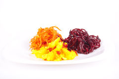 Cauliflower, carrots and beet. On a plate Stock Image