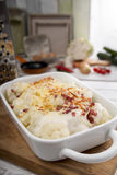 Cauliflower casserole with ham and bechamel sauce and cheese Royalty Free Stock Images