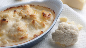 Cauliflower cheese with raw ingredients Stock Photo