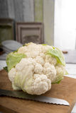 Cauliflower on chopping board Stock Photo