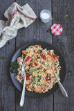 Cauliflower couscous with tomatoes and shrimps Stock Photos