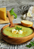 Cauliflower cream soup with cheese,herbs and curry. Stock Images