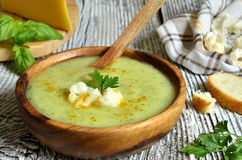 Cauliflower cream soup with cheese,herbs and curry. Royalty Free Stock Photos