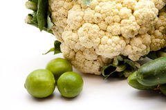 Cauliflower with cucumbers and limes. On white background Stock Images