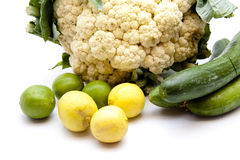 Cauliflower with cucumbers and limes. On white background Stock Photography