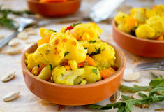 Cauliflower curry with pumpkin, paprika and arugula. Leaves stock photo