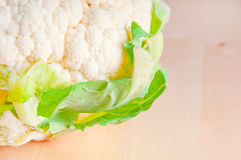 Cauliflower on cutting board Stock Images