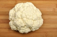 Cauliflower on a cutting board Royalty Free Stock Images